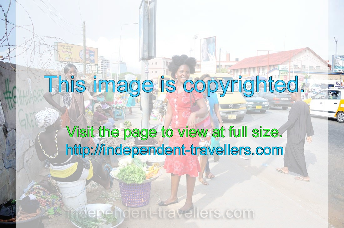 A good-looking woman in the red dress is on the Makola