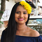 A gorgeous Sri Lankan lady with a yellow wreath in Galle Fort
