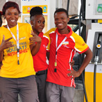 Lovely young employees are at the filling station somewhere between Mamuno Border Control and the town of Maun